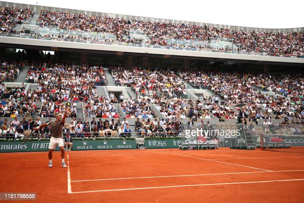 A general view as Roger Federer of Switzerland serves during his mens singles first round match against Lorenzo Sonego of Italy during Day one of the...