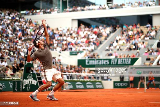 General view as Roger Federer of Switzerland serves during his mens singles first round match against Lorenzo Sonego of Italy during Day one of the...