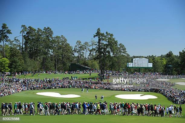 A general view as Rory McIlroy of Northern Ireland and Jordan Spieth of the United States putt on the second green during the third round of the 2016...