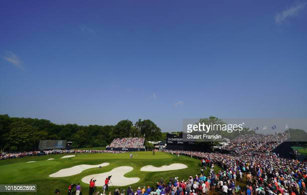 A general view as Rory McIlroy of Northern Ireland lines up a putt on the 18th green during the continuation of the weather delayed second round of...