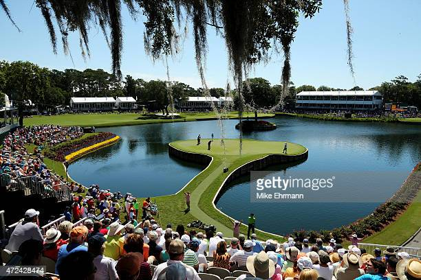A general view as Rory McIlroy of Northern Ireland putts on the 17th green during round one of THE PLAYERS Championship at the TPC Sawgrass Stadium...