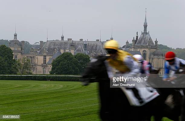 A general view as runers race up the straight with the Chateau de Chantilly in the background at Chantilly racecourse on June 5 2016 in Chantilly...