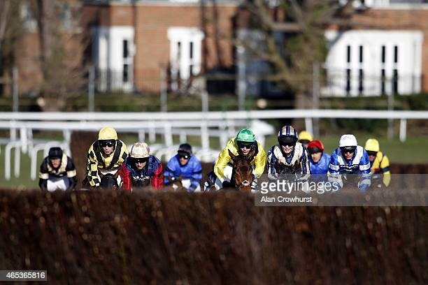 A general view as runners approach a fence at Sandown racecourse on March 06 2015 in Esher England