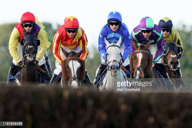 A general view as runners approach a fence at Wincanton Racecourse on October 17 2019 in Wincanton England