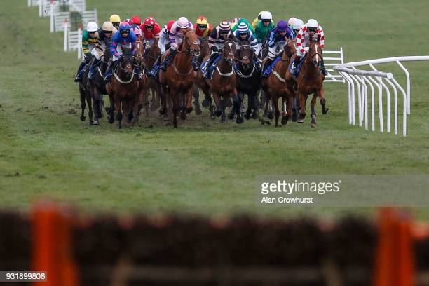 A general view as runners approach a flight of hurdles at Cheltenham racecourse on Ladies Day on March 14 2018 in Cheltenham England