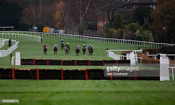 A general view as runners approach the second last flight of hurdles at Sandown racecourse on December 05 2015 in Esher England