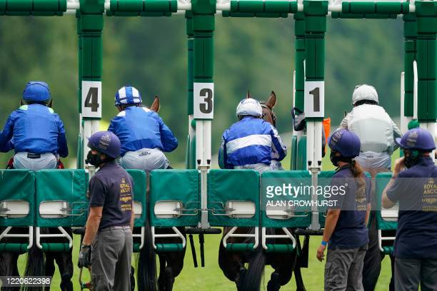 General view as runners break from the starting stalls in The King George V Stakes on day two of the Royal Ascot horse racing meet, in Ascot, west of...