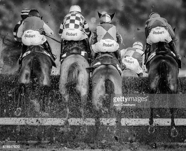 A general view as runners clear a fence at Ascot racecourse on November 25 2017 in Ascot United Kingdom