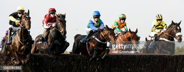 A general view as runners clear a fence at Huntingdon Racecourse on October 16 2018 in Huntingdon United Kingdom
