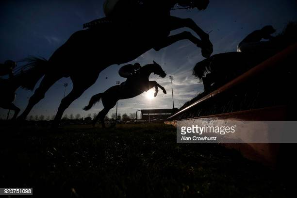A general view as runners clear a fence at Kempton Park racecourse on February 24 2018 in Sunbury England