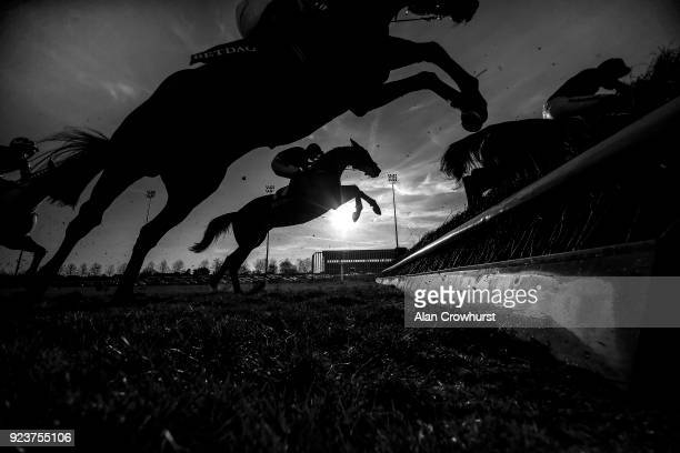 General view as runners clear a fence at Kempton Park racecourse on February 24, 2018 in Sunbury, England.
