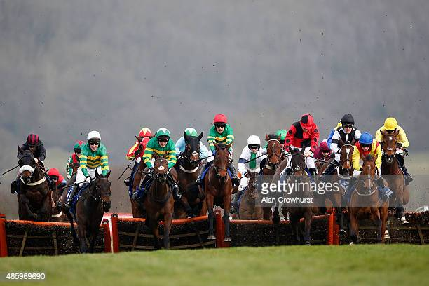 A general view as runners clear a flight of hurdles at Cheltenham racecourse on March 12 2015 in Cheltenham England