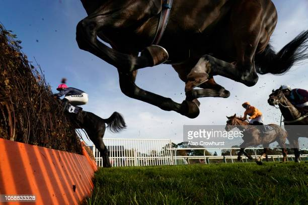A general view as runners clear a flight of hurdles at Fontwell Park Racecourse on October 24 2018 in Fontwell England
