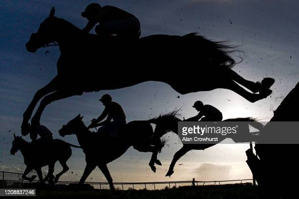 A general view as runners clear a flight of hurdles at Wincanton Racecourse on February 26 2020 in Wincanton England