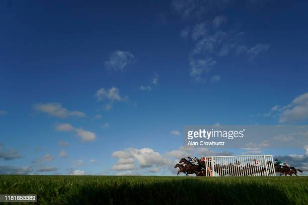 A general view as runners clear a flight of hurdles in the back straight at Wincanton Racecourse on October 17 2019 in Wincanton England