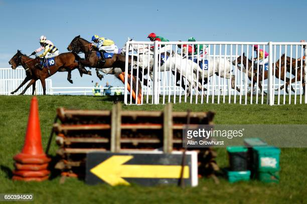 A general view as runners clear a flight of hurdles in the back straight at Wincanton Racecourse on March 9 2017 in Wincanton England