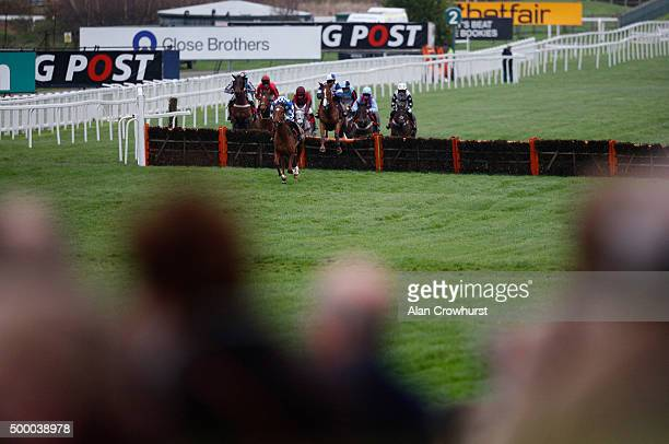 A general view as runners clear a flight of hurdles in the straight at Sandown racecourse on December 05 2015 in Esher England