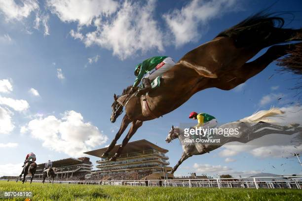 General view as runners clear the fence in front of the grandstands at Cheltenham racecourse on October 27, 2017 in Cheltenham, United Kingdom.