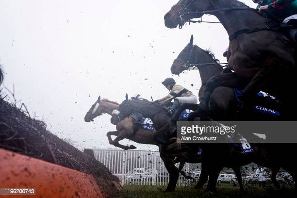 General view as runners clear the first fence in The Coral Welsh Grand National Handicap Chase at Chepstow Racecourse on December 27, 2019 in...