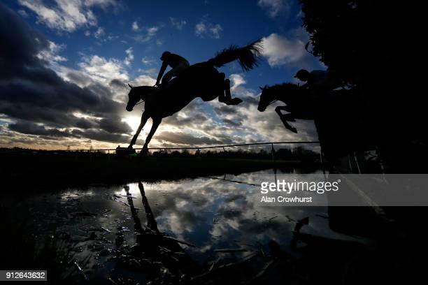 A general view as runners clear the water jump at Leicester racecourse on January 31 2018 in Leicester England