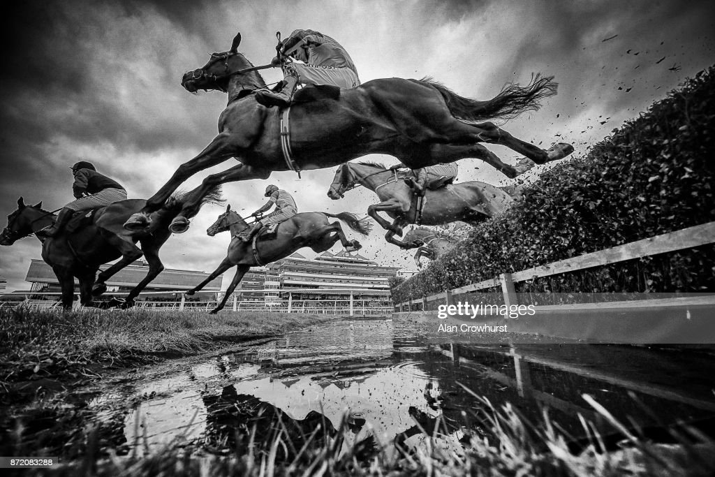 A general view as runners clear the water jump in The Dawnus Handicap Steeple Chase at Newbury racecourse on November 9, 2017 in Newbury, United Kingdom.
