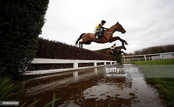 A general view as runners clear the water jump in The Dick Christian Novices' Steeple Chase at Leicester racecourse on January 26 2016 in Leicester...