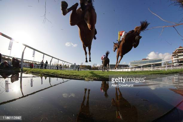 A general view as runners clear the water jump in The KKAHighpoint Beginners' Chase at Newbury Racecourse on November 07 2019 in Newbury England
