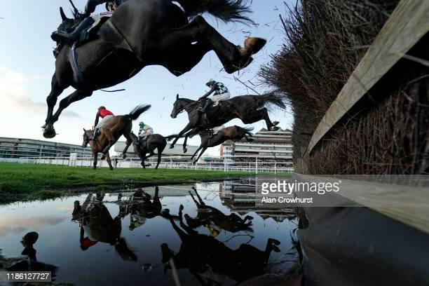 A general view as runners clear the water jump in The Micky Rawlings Memorial Handicap Chase at Newbury Racecourse on November 07 2019 in Newbury...