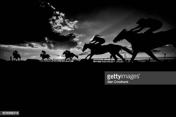 General view as runners climb the hill to the finish at Sandown Park racecourse on August 10, 2017 in Esher, England.