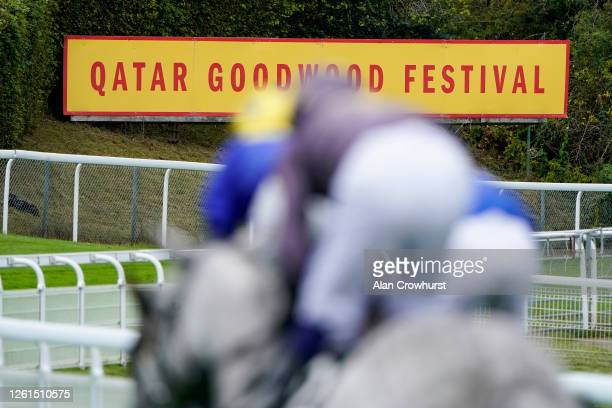 A general view as runners ease down after finishing at Goodwood Racecourse on July 28 2020 in Chichester England Owners are allowed to attend if they...