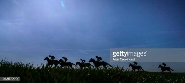 A general view as runners ease down after finishing at Newmarket racecourse on April 19 2018 in Newmarket England