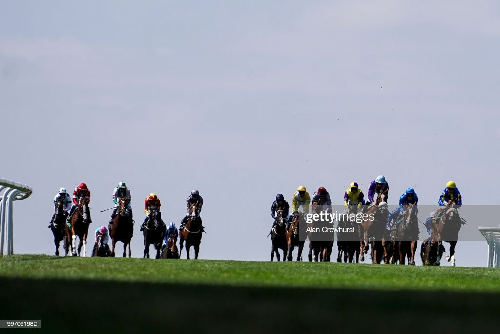 A general view as runners ease down after finishing at Newmarket Racecourse on July 12, 2018 in Newmarket, United Kingdom.