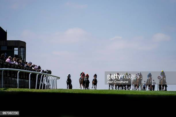 A general view as runners ease down after finishing at Newmarket Racecourse on July 12 2018 in Newmarket United Kingdom