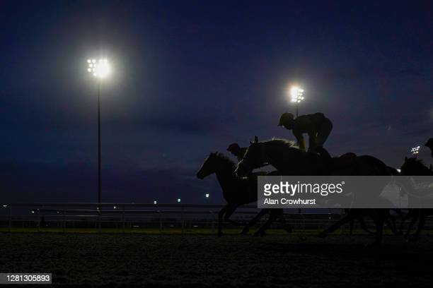 General view as runners ease down after finishing in The Unibet Extra Place Offers Every Day Handicap at Kempton Park Racecourse on October 20, 2020...