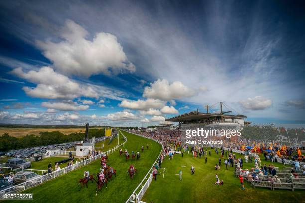 A general view as runners ease down after finishing on day one of the Qatar Goodwood Festival at Goodwood racecourse on August 1 2017 in Chichester...