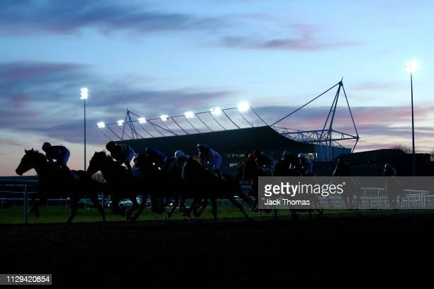 General view as runners go around the bend during the first race at Kempton Park on February 13, 2019 in Sunbury, England.