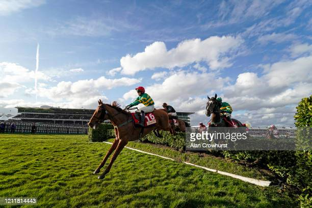 General view as runners in The Glenfarclas Chase clear the 'Bank with Hedges' on Ladies Day at Cheltenham Racecourse on March 11, 2020 in Cheltenham,...