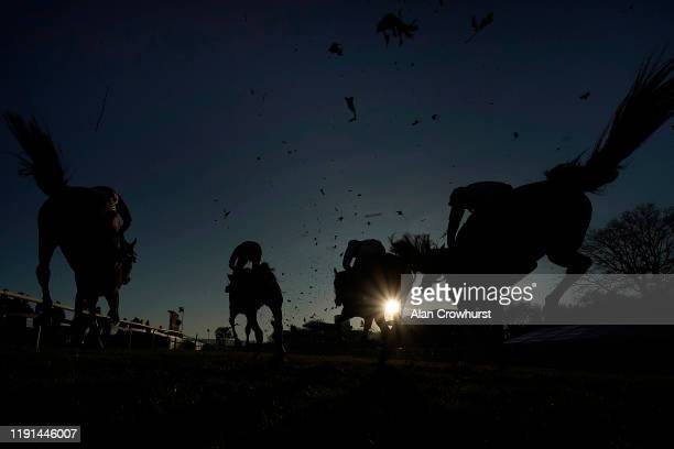 A general view as runners land over a fence at Plumpton Racecourse on December 02 2019 in Plumpton England