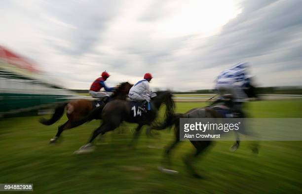 A general view as runners leave the stalls at Lingfield Park on August 24 2016 in Lingfield England