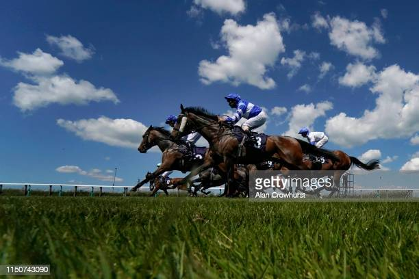 A general view as runners leave the stalls for the first race of the day at Brighton Racecourse on May 21 2019 in Brighton England