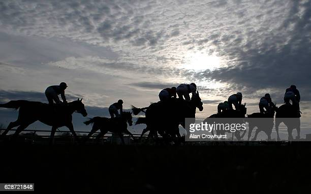 A general view as runners leave the start for The Unicorn Group Handicap Steeple Chase at Cheltenham Racecourse on December 9 2016 in Cheltenham...