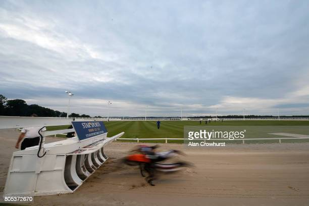 A general view as runners leave the traps at Towcester greyhound track on July 1 2017 in Towcester England