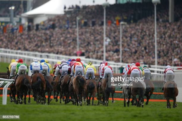A general view as runners lmake their way towards the first fence in The Ultima Handicap Steeple Chase at Cheltenham racecourse on day one of the...
