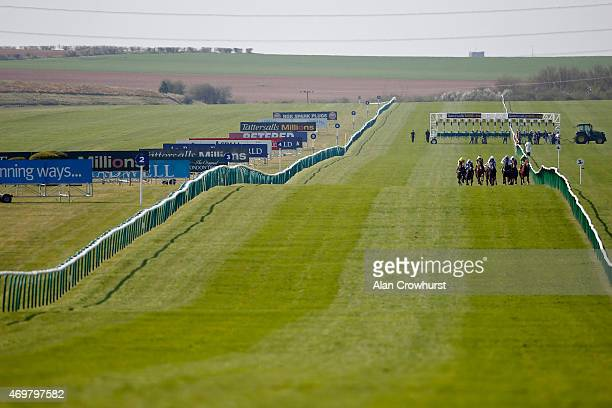 A general view as runners make their way down the course at Newmarket racecourse on April 15 2015 in Newmarket England