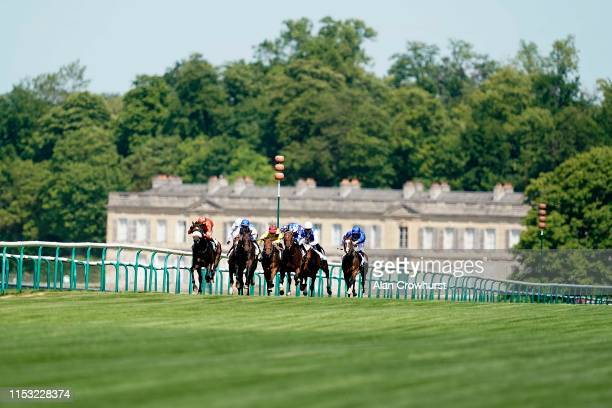 A general view as runners make their way down the straight during The Qipco Prix du Jockey Club meeting at Hippodrome de Chantilly on June 02 2019 in...