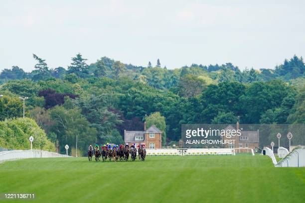 General view as runners make their way down the track in The Coventry Stakes on day five of the Royal Ascot horse racing meet, in Ascot, west of...