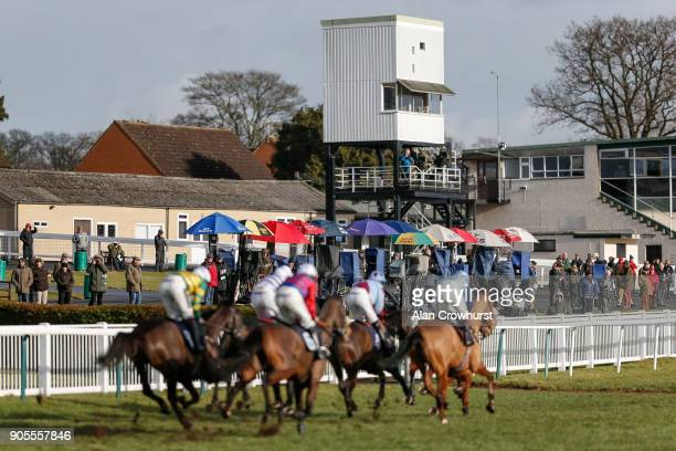 A general view as runners make their way past the bookmakers and racegoers at Hereford racecourse on January 16 2018 in Hereford England