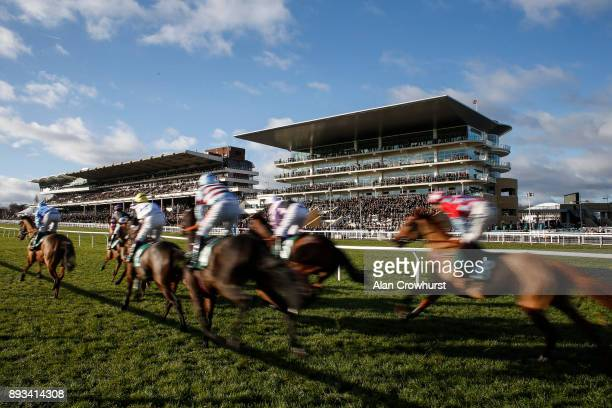 A general view as runners make their way past the grandstands at Cheltenham racecourse on December 15 2017 in Cheltenham United Kingdom