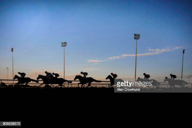 A general view as runners make their way towards the back straight at Kempton Park racecourse on July 5 2017 in Sunbury England