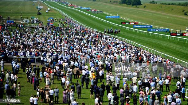 A general view as runners make their way towards the finish at Newmarket racecourse on July 12 2014 in Newmarket England